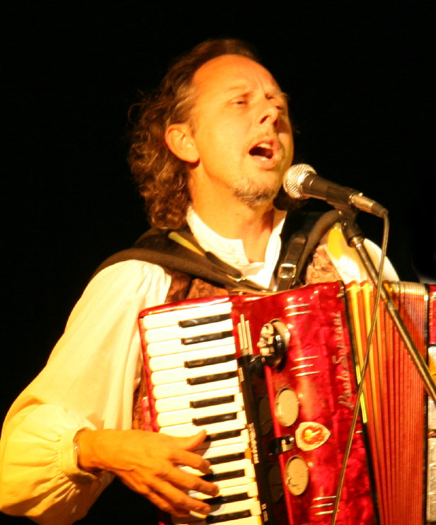 Filippo singing and playing accordion