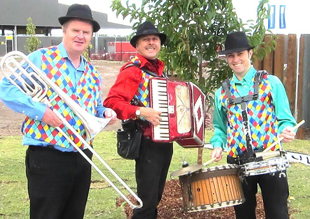 Skedaddle Roving musicians featuring trombone, accordion and drums